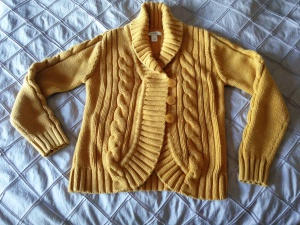 I told mom mustard was in so she took a picture of this classic cable knit cardigan that she picked up for $3.